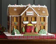 I love this cute gingerbread house!!! Plaid ribbon is adorbs and its simplicity makes it perfection!!!
