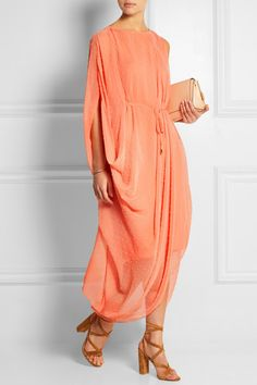 Saloni's peach Swiss-dot chiffon dress has a breezy feel that makes it ideal for sun-soaked getaways. Underpinned with a tonal slip, this relaxed, asymmetric style is cut with a draped sleeve and a flattering drawstring waist. Wear yours with flat or heeled sandals depending on the occasion.