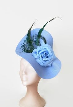 1428ad80d56e0 Light blue fascinator with feathers