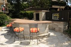 Photo by Dennis Miller. Dining counter and bar made from natural stone base with concrete countertop.