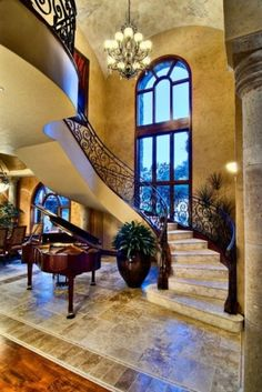 Mediterranean staircase. I adore the faux wall treatment as well.