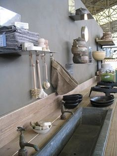 Soap stone sink.  Wood backsplash industrial kitchen
