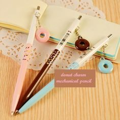 Say hello to this pretty little doughnut charm mechanical pencil! This pencil comes in 3 pretty flavors, Chocolate frosted, Blue frosted, and Pink Frosted and even has little colorful sprinkles that l