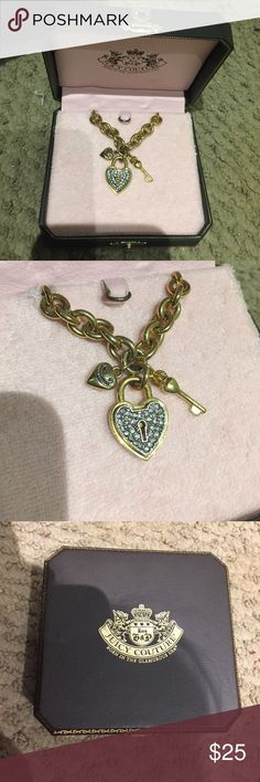Juicy Couture Gold Lock Charm Necklace A classic Juicy chain necklace that matched anything with both gold and silver on the necklace. Never worn! No tags. Juicy Couture Jewelry Necklaces