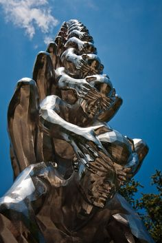 Karma is an intriguing sculptural installation by Korean artist Do Ho Suh that presents countless men sitting atop one another while shielding each other's eyes. Statues of Blinded Men Ascending High into the Sky Posted by Pinar on February 26, 2013 at 9:30am