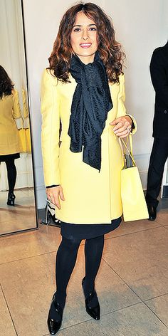 SALMA HAYEK Opting for winter pastels, Salma wears a soft-yellow jacket with a matching purse over a black dress and tights at the Stella McCartney holiday event in London.