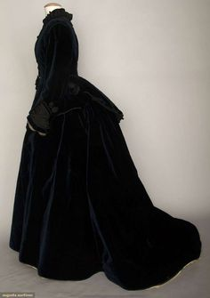 1870 Velvet Afternoon Dress: 2-piece blue-black velvet, apron front & back bodice w/ black silk trim,trained skirt, brown cotton bodice lining