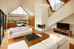 A Modern Design that Exceptionally Living Area The architectural firm RS + Robert Skitek designed a modern house with a unique roof structure. Barn House Design, Modern Barn House, My Living Room, Living Area, Chalet Canada, Houses In Poland, Architecture Design, House And Home Magazine, Inspired Homes