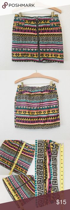 H&M Tribal Mini Skirt Zip up skirt • Bright multi-color print • Has pockets • Been altered to smaller size (see pictures for measurements) • Size says 12 but it fits an 8/10 now (PLEASE SEE PICTURES FOR MEASUREMENTS). Material is stretchy H&M Skirts Mini