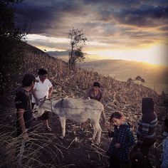 Phone photo: @ivankphoto Maggi Soria in white works with a group of volunteers to help an elderly man apply medication against parasites to his animals and repair his home on #Ilalo an extinct volcano above #Rumihuaico #Ecuador. #projectmibarrio @thephotosociety @panospictures @runa_photos by natgeo