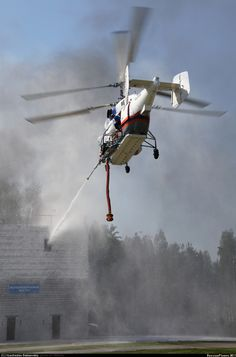 Another one of Kamov's famous co-axial designs, a Ka-32A/AO conducts firefighting training. Derived from the Ka-27 'Helix' airframe, the Ka-32 is a helicopter that was designed for the civilian world....