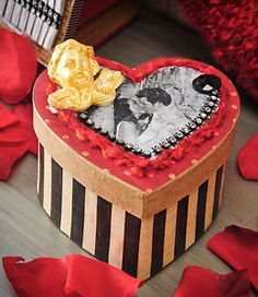 Modge podge and photos with cute embellishments used to decorate this cardboard box. You can dress this up any way you want for those special loved ones in your life.