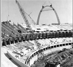 Busch Stadium 2 under construction, with a nearly completed Arch in the background. (Post-Dispatch photo - October 1965)
