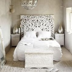 The emphasis in this space is the headboard. It leads the eye in all different directions and is very detailed.
