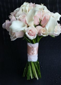 roses and calla lilies wedding bouquet   lace handle details on bouquet  www.lorasweddingflowers.com   Wedding flowers by Sophisticated Floral Designs. Portland, OR