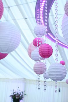 Mini paper lanterns look great hanging from different lengths of crystals at any bling wedding or party.