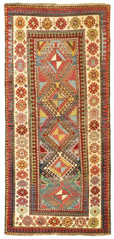 A Gendje Kazak long rug, Central Caucasus -    approximately 219 by 105cm; 7ft. 2in., 3ft. 5in., third quarter 19th century
