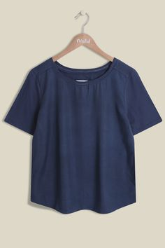A simple, semi-fitted T Shirt with a scoop neck and flattering short sleeves. Our Mila T Shirt is made from a mixture of soft cotton and light modal, with a hint of stretch for an extra comfy fit. To finish off we have included detailing around the neckline to make this T Shirt stands out from other basic T Shirts.   50% cotton, 50% modal  Machine cold wash  Fit: Slightly fitted  This T Shirt is 25 ins / 64 cms from the highest point to the hem in a size 12.
