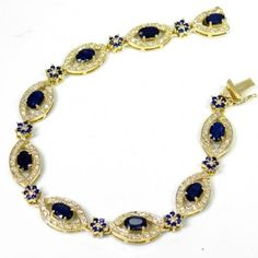 Bracelete em ouro Amarelo 18K, safira (6,0cts) e Diamantes (1,49cts). Código: 18Ke15