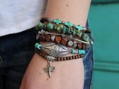 Bohemian Stretch Bracelets. How to put together a great bracelet combo: 1/ combine different shapes, colors and textures (love the mix of wood and turquoise beads here with silver accents scattered throughout), 2/ Use charms and dangles to add dimension to the bracelet stack (love the dragonfly charm hanging over the top of the hand), 3/ Choose neutral colors that will go with everything. More ideas at www.everdesigns.com