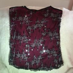 BKE BOUTIQUE  Red & Black Sequined Tank Top This is a beautiful deep red with black lace sequined & silver etched overlay. It's impossible to capture the subtle sparkle of the sequins paired with the unique silver etchings with a camera (believe me, I tried!).  It's a lacy tank that can be dressed up or down. Cute w/a skirt & heels or distressed jeans & booties. BKE Boutique Tops Tank Tops