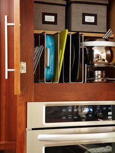 Integrated Appliances:  Grouping cooking appliances in the same location provides a refined, built-in look and conserves counter space. Cabinetry above the microwave oven stores baking supplies and dishes. Racks and bins corral items in easily accessible yet out-of-sight spaces.