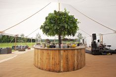 Oak Circular Bar by Shades - available to hire with any event.  #marqueehire #outdoorwedding #barhire #furniturehire #circularbar #weddingbar #weddingideas #roundbar