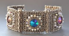 Hinged section beaded bracelet with bezeled rivoli centre Woven Bracelets, Gemstone Bracelets, Handmade Bracelets, Handcrafted Jewelry, Jewelry Crafts, Jewelry Art, Jewelry Design, Seed Bead Jewelry, Bead Jewellery