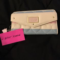 Betsey Johnson Wallet Gorgeous White, light pink, &. Light blue Betsey Johnson wallet with heart stitching. Lots of wallet &. Card space . Make an offer  Betsey Johnson Accessories Key & Card Holders