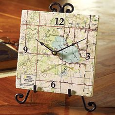 Artisans in New England will screen print a local map on tumbled marble to create a personalized clock for you.