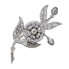 """Georgian style A ravishing and remarkable late-18th~early-19th century flower brooch masterfully crafted 'en tremblant': """"En tremblant"""" is a French term - meaning """"to tremble"""". It was first used to describe 18th and 19th century jewelry where parts of the diamond set pieces were attached to a trembler to create movement in the jewel when worn."""