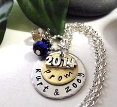 Allow 10 days for production time and please read all shop policies BEFORE ordering. This pretty prom necklace has two aluminum discs topped with a 2015 charm (the photo is last years so shows 2014 but will top it with 2015) and two faceted ball crystals, choice of colors. Comes on a pretty 24 inch silver plated rolo chain. Its a fabulous keepsake necklace for prom! More prom necklaces are in my shop: http://www.etsy.com/shop/CharmAccents  Discs: approx. 1 inch and 3/4. ~~Please specify two…