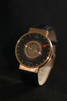 Carousel automatic timepiece with 12-hour self-axis rotating movement. Tailor made by our Master Watchmaker Aniceto Jiménez Pita. 18kt. Rose Gold case, rotor, lugs and buckle. Black crocodile strap. From $18,300.00