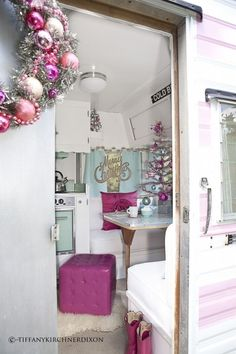 a vintage trailer decorated for the holidays