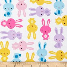 Urban Zoologie Bunnies Spring from @fabricdotcom  Designed by Anne Kelle for Kaufman Fabrics, this cotton print is perfect for quilting and craft projects as well as apparel and home décor accents. Colors include white, black, pink, purple, aqua and yellow.