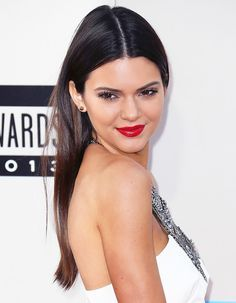 Kendall Jenner tucks her straight hair behind her ears