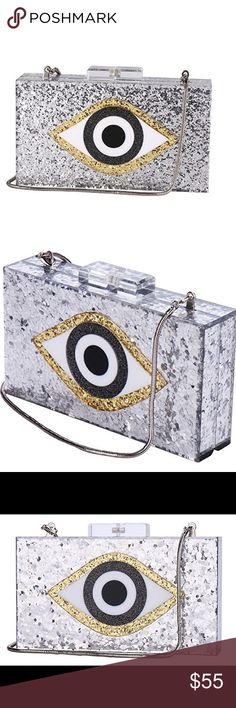 🆕 Unique Sparkly Silver and Gold Eye Clutch Purse Brand new and high quality. So unique!! Glitz and glam with a bold eye image. Comes with detachable chain. 👁 Bags Clutches & Wristlets