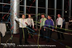 Garter streamer shot  Photo Credit- Ron Shuller Creative Images  #CincinnatiWedding #PartyPleasers #Streamershot