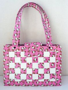 Duct tape...I have to find the Hello Kitty duct tape and make me this purse...I LUV IT