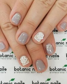 A wonderful looking gray and white nail art design for short nails. Arrange the embellishments into a lace design near the cuticle and add white flower embellishments as well on top for effect. Grey Nail Art, Gray Nails, Glitter Nail Art, Cute Nails, Pretty Nails, Nail Art Designs, Short Nails Art, Long Nails, Latest Nail Art