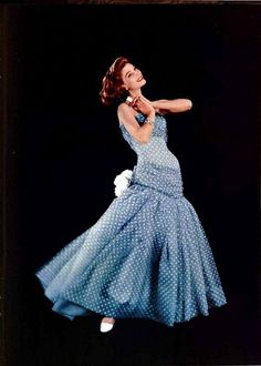 1956    Wearing a lovely mousseline evening gown by Madame Grès