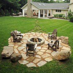 fireplace and seating near the house. Grill and seating. Sun chairs. Fire pit further away in the yard. Love