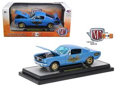 1966 Ford Mustang 2+2 GT Fastback Metalflake Blue 1/24 Diecast Model Car by M2 Machines - Brand new 1:24 scale diecast car model of 1966 Ford Mustang 2+2 GT Fastback Metalflake Blue die cast car by M2 Machines. This pony is set up as a vintage drag car. The paint is Blue with heavy metallic in it. Graphics are a large 427 emblem on the doors and a big Ford logo on the rear quarter panels. The glass is now tinted clear blue, while the interior is black with a roll bar and a 4 speed. Now onto…
