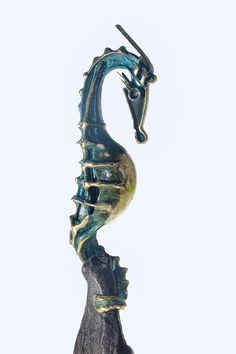 Unique Sea Horse bronze sculpture on beautiful foundation of black granite  Impressive bronze decor for your home, your summer house near the coast. Animal bronze sculpture is a perfect corporate gift for office. This bronze seahorse will be beautiful decoration of your fireplace. This Metal bronze sculpture is a great gift idea for a loved one, wedding or anniversary.  Approximate size:  28/8/6 cm 11 /3.1/ 2.4 in  Weight 1.000 kg  The bronze sculpture is cast by means of ...