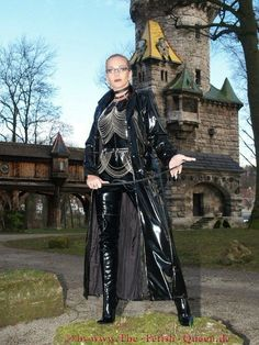 Heike, The Retish Queen. Black Vinyl Long Coat, Catsuit decorated With Chains & Over the Knee Boots.