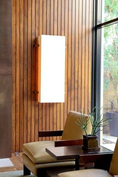 Vertical and thin. Create a distinctively modern look with a vertical installation of thin wood slats. I would go with a 3-inch wood strip for this look. I like the idea of having spaces in between the slats to allow for backlighting.