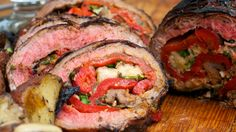 A delicious grilled steak stuffed with cheese, salty prosciutto, roasted red peppers and sweet basil.