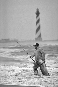 Reminds me of my Dad fishing at Cape Hatteras. Fishing in the surf near Cape Hatteras Lighthouse. Photograph courtesy of North Carolina Division of Tourism, Film, and Sports Development. Saltwater Fishing Gear, Surf Fishing, Gone Fishing, Trout Fishing, Bass Fishing, Fishing Boats, Fishing Tips, Fishing Stuff, Deep Fishing