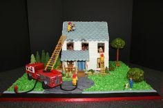 - This is my 2010 entry for our local Gingerbread contest.  This is a house that is on fire.  You can't see the lighting in the picture but it had flickering red lights inside to look like flames and the firetruck lights blinked and rotated and the spot light shined on the girl.  I won 1st place.  It was a tribute to my dad and brother who were both firefighters.