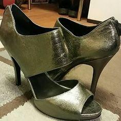 Nine West Heels Metallic grey heel. Some wear to sole. But still in good condition. Heel height 4.5 and size 11 Nine West Shoes Heels